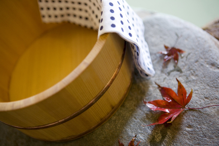 tubs: Autumn leaves and open-air bath tubs Stock Photo