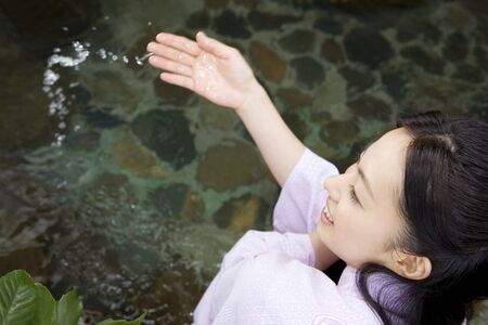 warm water: Women see the hot water acceleration of open-air bath