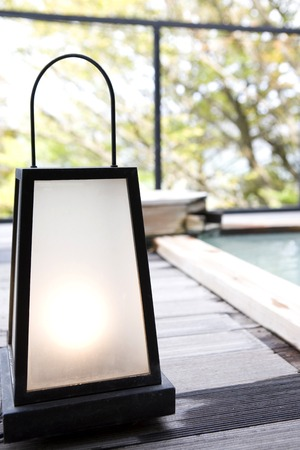 outdoor lighting: Sum lamp placed on the side of the open-air bath Stock Photo