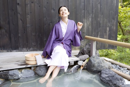 Women who put a foot on the open-air bath