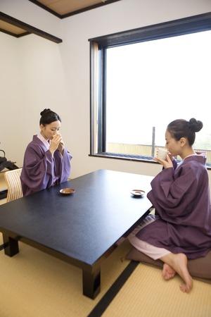 inn: 2 women drinking tea at the inn of the room