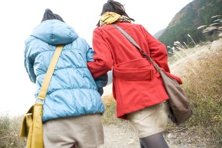 tourist attraction: 2 women of Rear walking tourist attraction Stock Photo