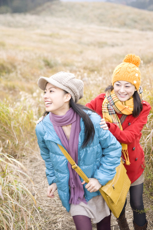 attraction: Two women walk through attraction Stock Photo