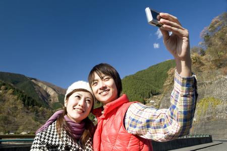 commemorative: Couples take a commemorative photo Stock Photo