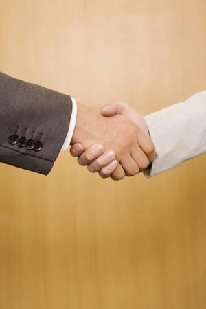 2 の手と握手するビジネスマン 写真素材