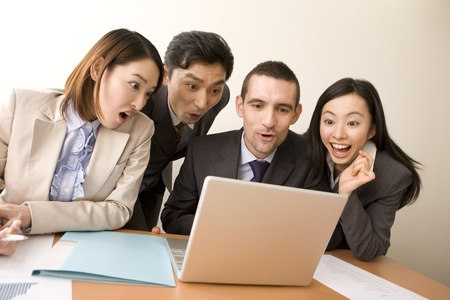 personal computer: Businessman and OL surrounding the personal computer