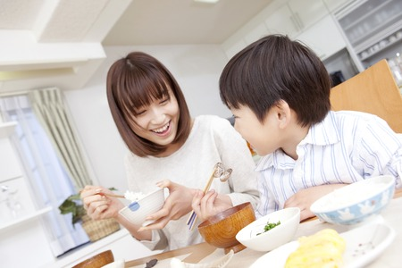 Mother and son to eat rice at breakfast Stock Photo