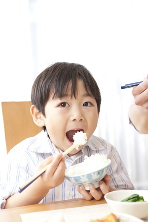 Boy eating rice