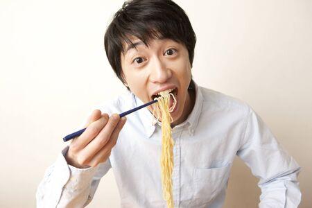 Men eat ramen