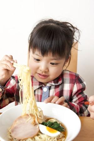 eating noodles: Girl eating noodles