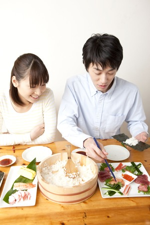 dry provisions: Men make the hand-rolled sushi