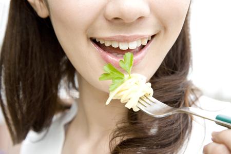eating pasta: LIFESTYLE IMAGE-a woman eating pasta