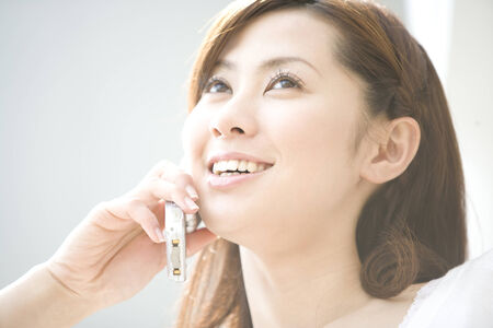 LIFESTYLE IMAGE-close-up shot of a  Japanese woman talking with her mobile Stock Photo - 6805204