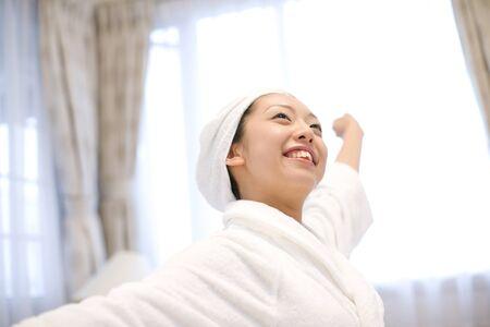 woman bathrobe: Woman who was wearing a bathrobe Stock Photo