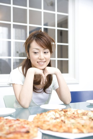 human's elbow: Women who eat a pizza Stock Photo
