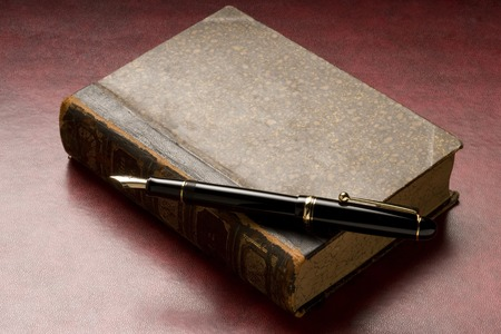 writing utensil: Antique book and pen Stock Photo