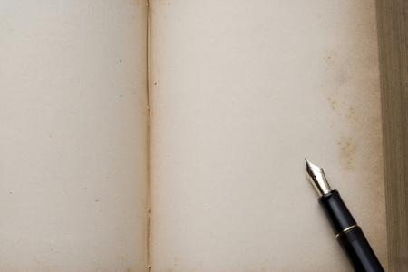 hon: Antique book and pen Stock Photo