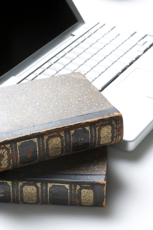 antique books: Antique books and computer Stock Photo