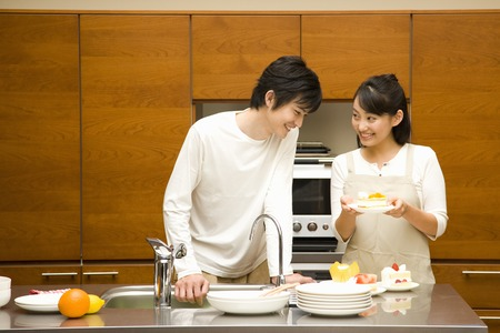 A young loving couple in their kitchen photo