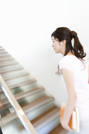 go up: Women who go up the stairs Stock Photo