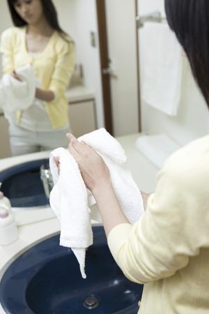 handwash: Women wipe their hands