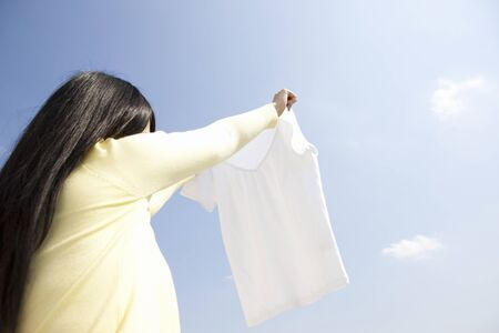 hang out: Woman hang out the laundry