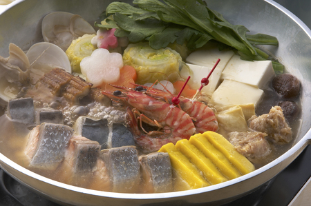 wrestlers: Sumo wrestlers hotchpotch in pot. Stock Photo