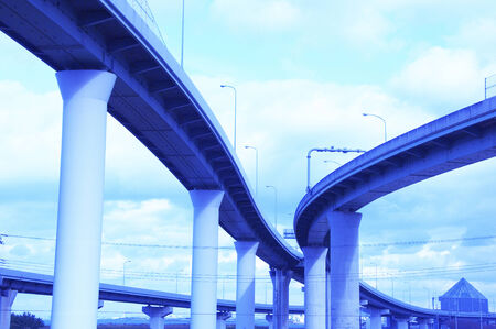 intersects: The superhighway which intersects and sunny blue sky. Stock Photo