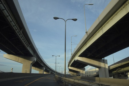 intersects: The highway which intersects and blue sky. Stock Photo
