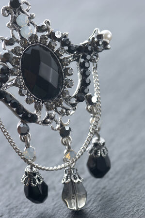gorgeousness: The accessory made by silver and black stone. Stock Photo