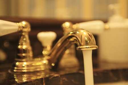 gorgeousness: The sink with a gold faucet.