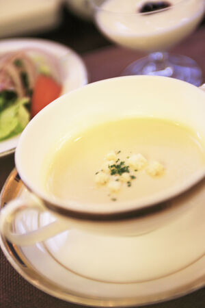 potage: Potage in the cup and some dishes on the table.