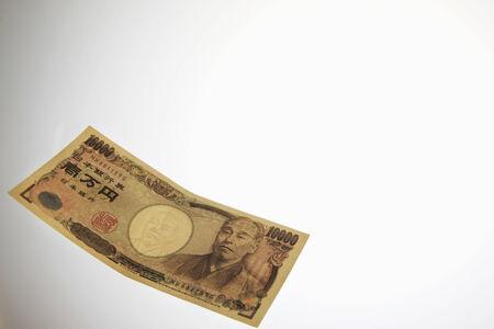 A paper money and white background. 版權商用圖片