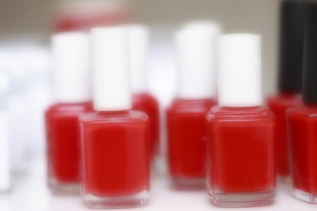 esthetics: A lot of red manicure on the table. Stock Photo
