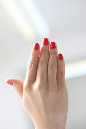Woman with red nail polish Stock Photo