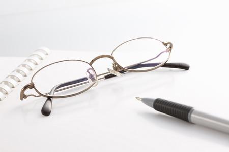 writing utensil: Glasses and pen