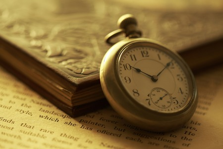 Pocket watches and books Stock Photo