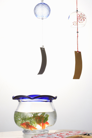 fishbowl: Wind chimes and a fishbowl and fan Stock Photo