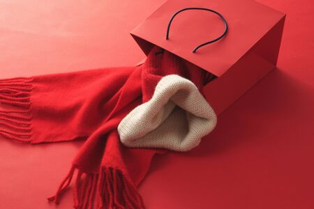 swagger: Red scarf and hat and paper back