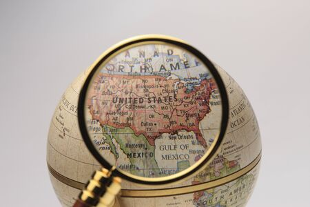 see the usa: Globe and magnifying glass Stock Photo