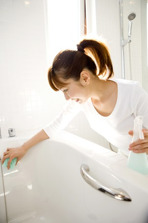 wife of bath: Japanese woman cleaning up the bathtub Stock Photo