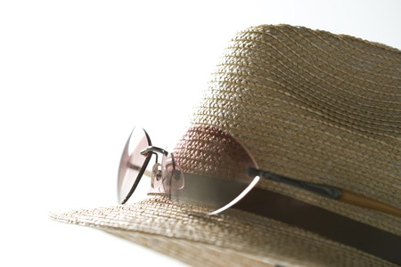 ultraviolet: Sunglasses and straw hat Stock Photo