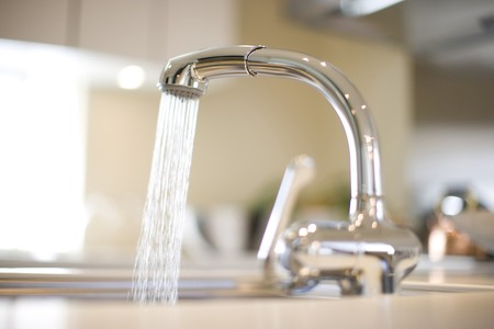 still water: Faucet Stock Photo
