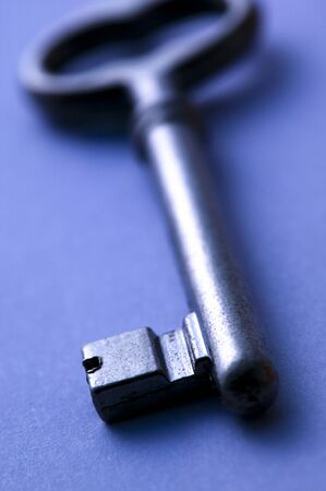 Old type key isolated on blue background Stock Photo - 6903355