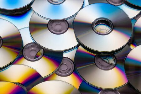 dvds: Pile of many CDs or DVDs background