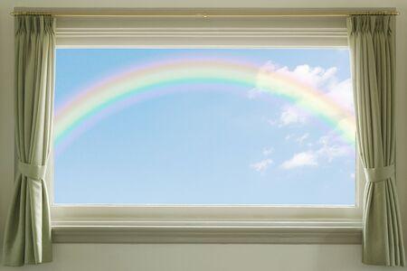青い空白い雲や窓の虹