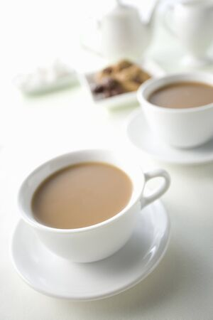 cafe au lait: Two cups of cafe au lait and cookies Stock Photo