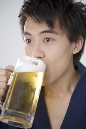 yukata: Drink beer yukata men Stock Photo