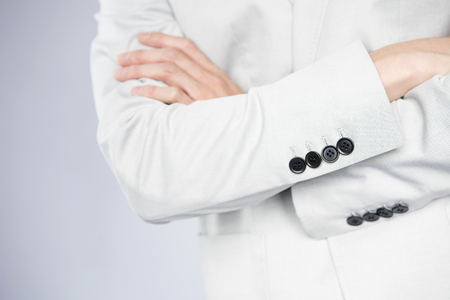 fold ones arms: Hand of businessman that his arms folded