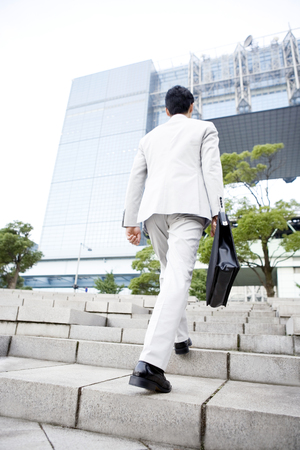 back shot: back shot of businessman walking